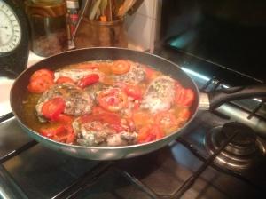 Cosce di pollo in cottura